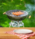 Row of grilled sausages close-up view. Row grilled grill sausages table color blue stock photos