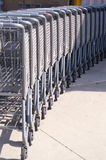Row of Grocery Carts. Lined up row of grocery carts, ready for shoppers royalty free stock photo