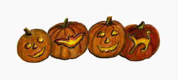 Row of  Halloween Pumpkins with Carved Faces. Royalty Free Stock Photos