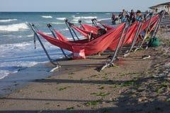 Row of hammocks on seashore in Vama Veche in Romania Stock Image