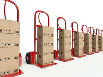 Row of hand trucks with cardboard boxes Royalty Free Stock Photography