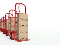 Row of hand trucks with cardboard boxes Royalty Free Stock Photos