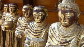 Row of handcrafted ceramic Buddha statues stock footage