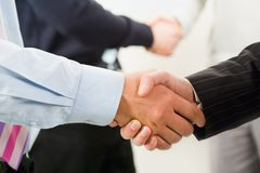 Row of handshakes. Image of row of business people shaking hands stock image