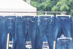 Row of hanged blue jeans Royalty Free Stock Photos