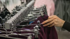 Row of hangers in the department store. royalty free stock images