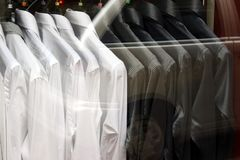Black shirts and white shirts contrast stock image
