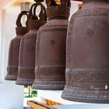 Row of hanging buddhist religious bells in Thailand temple Royalty Free Stock Photography