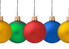 Row of hanging Christmas baubles stock photography