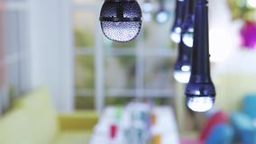 Lamps in the form of a microphone. A row of hanging lamps in the form of a microphone stock video