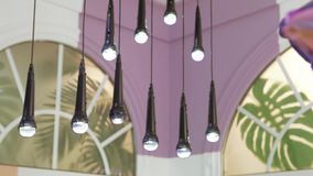 Lamps in the form of a microphone. A row of hanging lamps in the form of a microphone stock footage