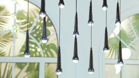 Lamps in the form of a microphone. A row of hanging lamps in the form of a microphone stock video footage