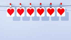 A row of hanging paper Valentine`s Day hearts - viewed from the center Stock Photography