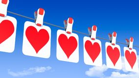 A row of hanging paper Valentine`s Day hearts - viewed from the left side Royalty Free Stock Photos