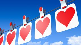 A row of hanging paper Valentine`s Day hearts - viewed from the right side Royalty Free Stock Photo