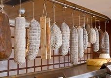 Row of hanging salami Stock Photography