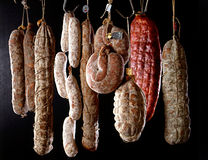 Row of hanging salamis Stock Image
