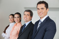 Row of happy businesspeople stock image