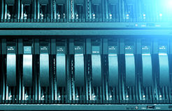 Row of hard disks close-up with ligh. The concept of information technology . Stock Photography