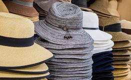 Row of hats on shelves. Row of colorful sunhats and Panama hats on shelves in a shop Stock Images