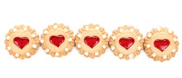 Row heart shaped strawberry biscuit. Royalty Free Stock Image