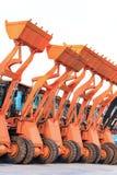 Row of heavy construction excavator machine Royalty Free Stock Photos