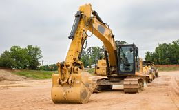 Heavy construction machinery lined up at a job site. stock photography