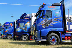 Row of Heavy Trucks with Artwork in a Show Stock Photo