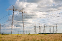 Row of high voltage masts Stock Images