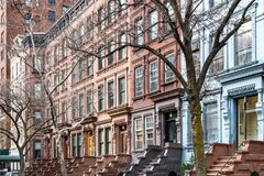 Row of historic brownstone buildings in New York City. Row of historic brownstone buildings in the Upper West Side of Manhattan in New York City stock photo