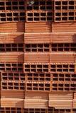 A row of hollow clay bricks background Stock Photo