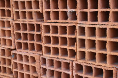 A row of hollow clay bricks - background Stock Images