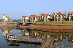 Row of homes or houses. A row of new homes is by a lake stock photo
