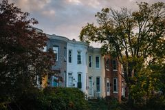 Row homes at sunset, on Remington Avenue in Remington, Baltimore, Maryland.  stock photos