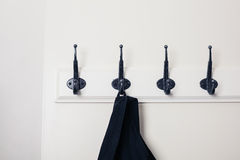 Row of hooks with jacket Stock Images