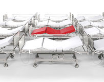 Row of hospital white beds - red stands out Stock Photos