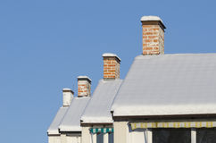 Row of house chimneys and rooftops wintertime Royalty Free Stock Photography