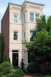 Row House Detail 106. Lush landscaping and decorative elements makes this brick home welcoming Stock Photos