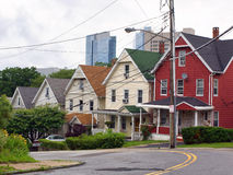 Row Houses. View of row houses with high rise development the background Stock Image