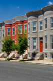 Row Houses. Colorful row houses on a quiet, sunny city street Royalty Free Stock Image