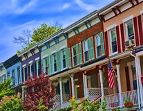 Row Houses. View of suburban street featuring colorful row houses Stock Images