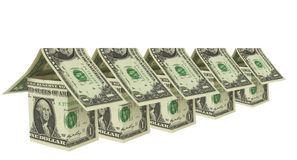 Row of houses from american dollar bills Stock Photos