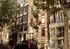 Row houses in Amsterdam. Exquisite homes in old Amsterdam Royalty Free Stock Photography