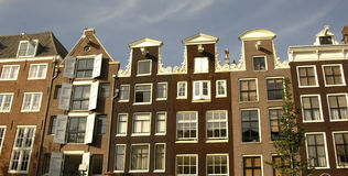 Row houses in Amsterdam. Exquisite homes in old Amsterdam Stock Photos