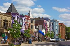 Row houses and businesses in Adams Morgan neighborhood. WASHINGTON DC, USA – MAY 9, 2015: Row houses and businesses in Adams Morgan neighborhood on a perfect Royalty Free Stock Images