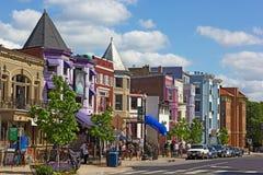 Row houses and businesses in Adams Morgan neighborhood. WASHINGTON DC, USA – MAY 9, 2015: Row houses and businesses in Adams Morgan neighborhood on a perfect Royalty Free Stock Images