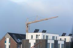 Row houses and construction crane. Stock Photo