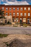 Row houses and cracked sidewalk in Baltimore, Maryland. Row houses and cracked sidewalk in Baltimore, Maryland Royalty Free Stock Photos