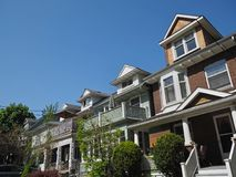 Row of houses. With dormer windows and large porches Royalty Free Stock Image
