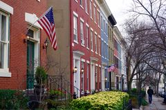 Row houses with flags flying Stock Photo